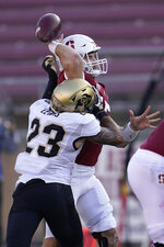 Stanford quarterback Davis Mills, top, is hit by Colorado safety Isaiah Lewis (23) while throwing a pass during the second half of an NCAA college football game in Stanford, Calif., Saturday, Nov. 14, 2020. (AP Photo/Jeff Chiu)