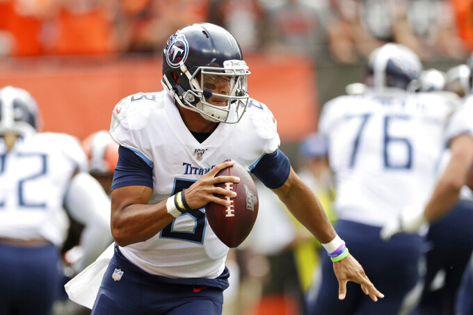 Tennessee Titans quarterback Marcus Mariota looks to pass during the first half in an NFL football game against the Cleveland Browns, Sunday, Sept. 8, 2019, in Cleveland. (AP Photo/Ron Schwane)