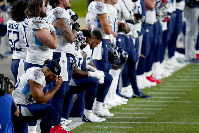 Some of the Tennessee Titans kneel during the national anthem prior to an NFL football game against the Denver Broncos, Monday, Sept. 14, 2020, in Denver. (AP Photo/Jack Dempsey)