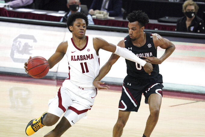 FILE - In this Feb. 9, 2021, file photo, Alabama guard Joshua Primo (11) drives against South Carolina guard AJ Lawson (00) during an NCAA college basketball game in Columbia, S.C. Primo was selected by the San Antonio Spurs in the NBA draft Thursday, July 29, 2021. (AP Photo/Sean Rayford, File)