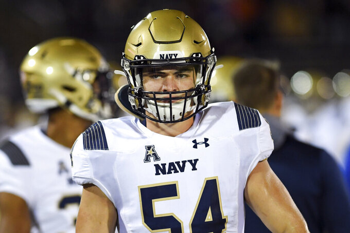 FILE - Navy linebacker Diego Fagot (54) gets ready to go in during the first half of an NCAA college football game against Connecticut, Friday, Nov. 1, 2019, in East Hartford, Conn. The key to the Navy defense is 6-foot-3, 240-pound linebacker Diego Fagot, who led the Midshipmen with 100 tackles last year as a sophomore. (AP Photo/Stephen Dunn, File)