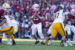 Stanford quarterback Davis Mills (15) looks to throw a pass against California during the first half of an NCAA college football game Saturday, Nov. 23, 2019 in Stanford, Calif. (AP Photo/Tony Avelar)