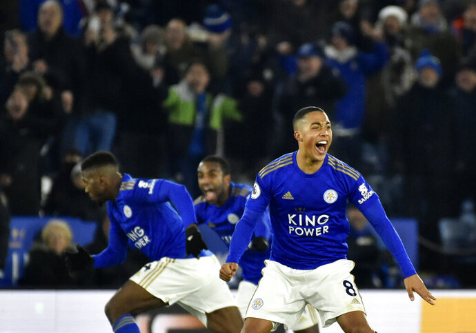 Leicester City players celebrate after Leicester's Kelechi Iheanacho scoring his side's second goal during the English Premier League soccer match between Leicester City and Everton at the King Power Stadium in Leicester, England, Sunday, Dec. 1, 2019. (AP Photo/Rui Vieira)