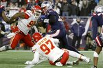 Kansas City Chiefs defensive ends Chris Jones, left, and Alex Okafor put pressure on New England Patriots quarterback Tom Brady, center, in the first half of an NFL football game, Sunday, Dec. 8, 2019, in Foxborough, Mass. (AP Photo/Steven Senne)