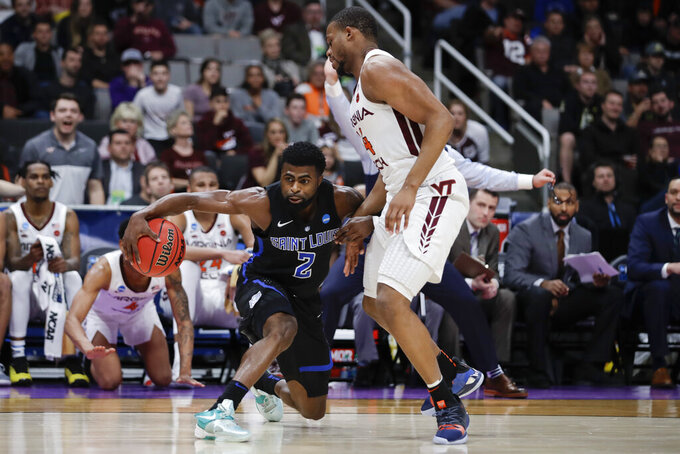 Saint Louis guard Tramaine Isabell Jr. drives to the basket around Virginia Tech forward P.J. Horne during the first half of a first-round game in the NCAA men's college basketball tournament Friday, March 22, 2019, in San Jose, Calif. (AP Photo/Ben Margot)