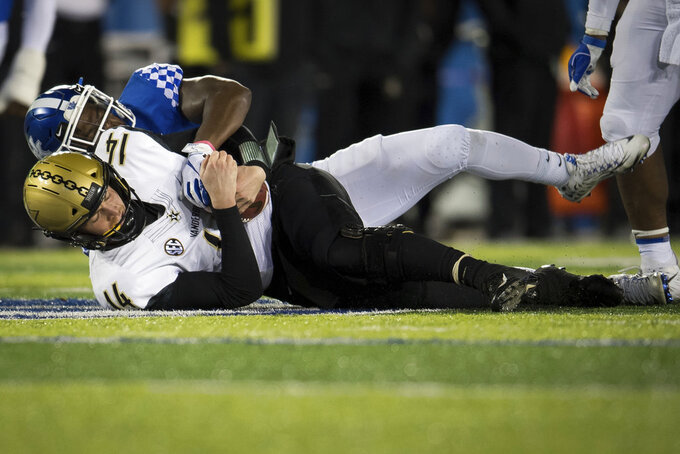 Kentucky offensive tackle Naasir Watkins (66) sacks Vanderbilt quarterback Kyle Shurmur during the second half of an NCAA college football game in Lexington, Ky., Saturday, Oct. 20, 2018. Kentucky won, 14-7. (AP Photo/Bryan Woolston)