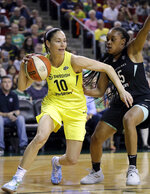 FILE - In this Aug. 17, 2018, file photo, Seattle Storm's Sue Bird (10) tries to get past New York Liberty's Brittany Boyd during the first of a WNBA basketball game, in Seattle. Sue Bird needs arthroscopic surgery on her left knee and will be out indefinitely, another big blow for the defending WNBA champs. The Storm announced Tuesday, May 21, 2019, that the 11-time All-Star has a loose body in her left knee. Bird will undergo surgery in Connecticut in the near future.(AP Photo/Elaine Thompson)