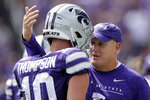 Kansas State head coach Chris Klieman talks to Kansas State quarterback Skylar Thompson (10) during the first half of an NCAA college football game against Bowling Green Saturday, Sept. 7, 2019, in Manhattan, Kan. (AP Photo/Charlie Riedel)