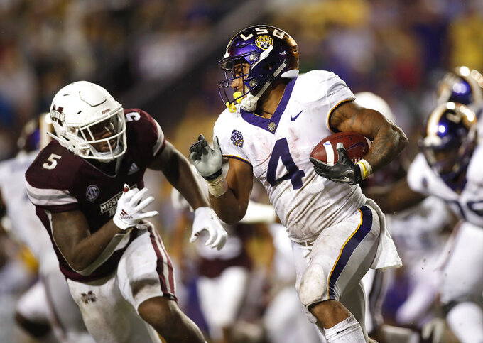 LSU running back Nick Brossette (4) runs past Mississippi State defensive end Chauncey Rivers (5) during an NCAA college football game in Baton Rouge, La., Saturday, Oct. 20, 2018. LSU won 19-3. (AP Photo/Tyler Kaufman)