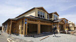 FILE - This May 4, 2018 file photo shows a house under construction in Roseville, Calif. California's unemployment rate edged up slightly in March even as the state continued adding jobs. The state Employment Development Department reported Friday, April 19, 2019 that the rate increased a tenth of a percentage point over February, to 4.3 percent.  (AP Photo/Rich Pedroncelli, File)