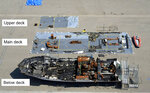This undated photo provided by the National Transportation Safety Board (NTSB) shows the wreckage of the dive boat Conception on a dock in Southern California. Federal investigators say the lack of a required roving night watchman aboard a scuba dive boat delayed the detection of a fire that killed 34 people off the coast of Southern California. Investigators told the National Transportation Safety Board on Tuesday, Oct. 20, 2020 that because some of the passengers' bodies were recovered wearing shoes, they believe they were awake and trying to escape before being overcome with smoke. (NTSB via AP)