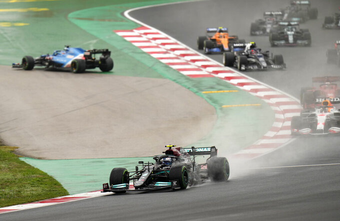 Mercedes driver Valtteri Bottas of Finland leads at the start of the Turkish Formula One Grand Prix at the Intercity Istanbul Park circuit in Istanbul, Turkey, Sunday, Oct. 10, 2021. (AP Photo/Francisco Seco)