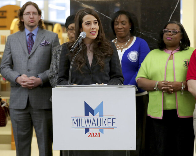 In this Thursday, Jan. 30, 2020 photo, Liz Gilbert, president of the Milwaukee 2020 Host Committee, speaks during a press conference providing information for those wishing to volunteer for the 2020 Democratic National Convention in MIlwaukee. The two leaders of Milwaukee's host committee for the 2020 Democratic National Convention have been placed on leave pending an investigation into allegations that they oversaw a toxic work environment, a letter sent to staff working on planning the event revealed. The two leaders of Milwaukee's host committee for the 2020 Democratic National Convention, the group's president Liz Gilbert, and its chief of staff Adam Alonso, have been placed on leave pending an investigation into allegations that they oversaw a toxic work environment, according to a letter sent to staff working on planning the event.  (Mike De Sisti/Milwaukee Journal-Sentinel via AP)