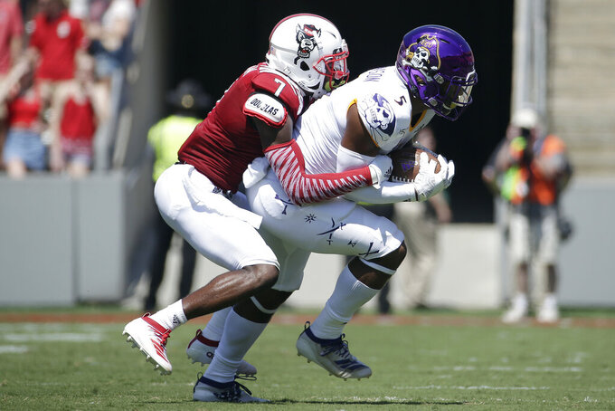 North Carolina State cornerback Chris Ingram (7) tackles East Carolina wide receiver C.J. Johnson (5) during the first half of an NCAA college football game in Raleigh, N.C., Saturday, Aug. 31, 2019. (AP Photo/Gerry Broome)