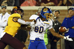South Dakota State running back C.J. Wilson (80) drops the ball against the defense of Minnesota defensive back Antoine Winfield Jr., left, during an NCAA college football game Thursday, Aug. 29, 2019, in Minneapolis. (AP Photo/Stacy Bengs)