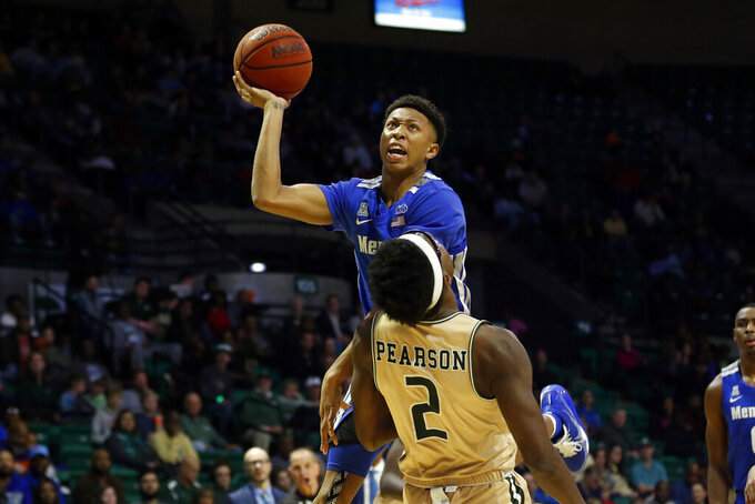 UAB forward Tamell Pearson (2) draws the charge as Memphis guard Boogie Ellis (5) puts up a shot during the second half of an NCAA college basketball game Saturday, Dec. 7, 2019, in Birmingham, Ala. (AP Photo/Butch Dill)