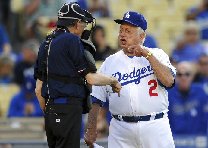 Hall of Fame and former Los Angeles Dodgers manager Tommy Lasorda passed away at the age of 93. Former Los Angeles Dodgers manger Tommy Lasorda argues with home plate umpire Larry King during the Old-Timers game prior to a baseball game between the Atlanta Braves and the Los Angeles Dodgers on Saturday, June 8, 2013 in Los Angeles. (Keith Birmingham/The Orange County Register via AP)