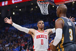 Houston Rockets guard Russell Westbrook (0) defends as Oklahoma City Thunder guard Chris Paul (3) looks to inbound the ball during the ball during the first half of an NBA basketball game Thursday, Jan. 9, 2020, in Oklahoma City. (AP Photo/Sue Ogrocki)