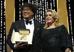 Director Bong Joon-ho, winner of the Palme d'Or award for the film 'Parasite', left, and actress Catherine Deneuve during the awards ceremony at the 72nd international film festival, Cannes, southern France, Saturday, May 25, 2019. (Photo by Vianney Le Caer/Invision/AP)