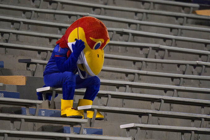Kansas Jayhawk mascot sits in the empty stands during the second half of an NCAA college football game against Coastal Carolina in Lawrence, Kan., Saturday, Sept. 12, 2020. Coastal Carolina defeated Kansas 38-23. (AP Photo/Orlin Wagner)