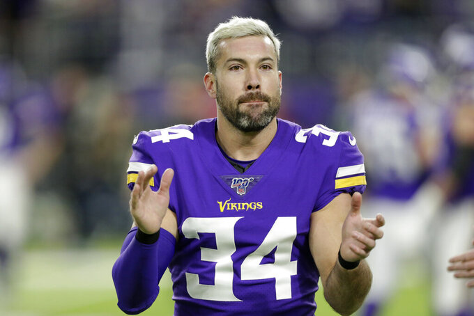 FILE - In this Dec. 23, 2019, file photo, Minnesota Vikings strong safety Andrew Sendejo warms up before an NFL football game against the Green Bay Packers in Minneapolis. The Cleveland Browns have added another veteran safety to their secondary, agreeing to terms with Andrew Sendejo on a one-year, $2.25 million contract. The 32-year-old Sendejo played for Minnesota and Philadelphia last season. (AP Photo/Andy Clayton-King, File)