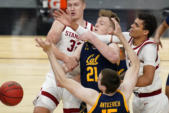 Clockwise from top left, Stanford's Lukas Kisunas (32), Lars Thiemann, Oscar da Silva and California's Grant Anticevich battle for a rebound during the second half of an NCAA college basketball game in the first round of the Pac-12 men's tournament Wednesday, March 10, 2021, in Las Vegas. (AP Photo/John Locher)