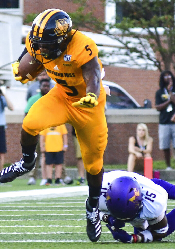 Southern Mississippi wide receiver Tim Jones (5) dodges a tackle attempt from Alcorn State defensive back Keyron Kinsler Jr. (15) during the first quarter of an NCAA college football game Saturday, Aug. 31, 2019, in Hattiesburg, Miss. Southern Mississippi won 38-10. (Cam Bonelli/Hattiesburg American via AP)