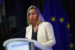 European Union foreign policy chief Federica Mogherini addresses the audience during a high level conference about Venezuela migration crisis, in Brussels, Monday, Oct. 28, 2019. Hundreds of representatives from governments, international agencies and charity groups gathered in Brussels Monday for a