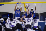 TCU place kicker Griffin Kell (39) kicks a field goal over Kansas defenders Malcolm Lee (99), Alonso Person (23) and Caleb Sampson (98) during the first half of an NCAA college football game in Lawrence, Kan., Saturday, Nov. 28, 2020. (AP Photo/Orlin Wagner)