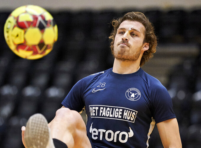 FILE - In this Dec. 11, 2019 file photo, Erik Sviatchenko participates in training in Ikast, Denmark. Denmark will be one of the first countries in European soccer to resume league play after the virus outbreak. Games are slated to be played from May 28 with hopes of finishing the season by the end of July. That's great news for FC Midtjylland because the club from central Denmark was leading the league by 12 points and closing in on its third league title in six seasons. Midtjylland captain Erik Sviatchenko says soccer returning will boost the morale of the nation. (Claus Bonnerup/Ritzau Scanpix via AP)