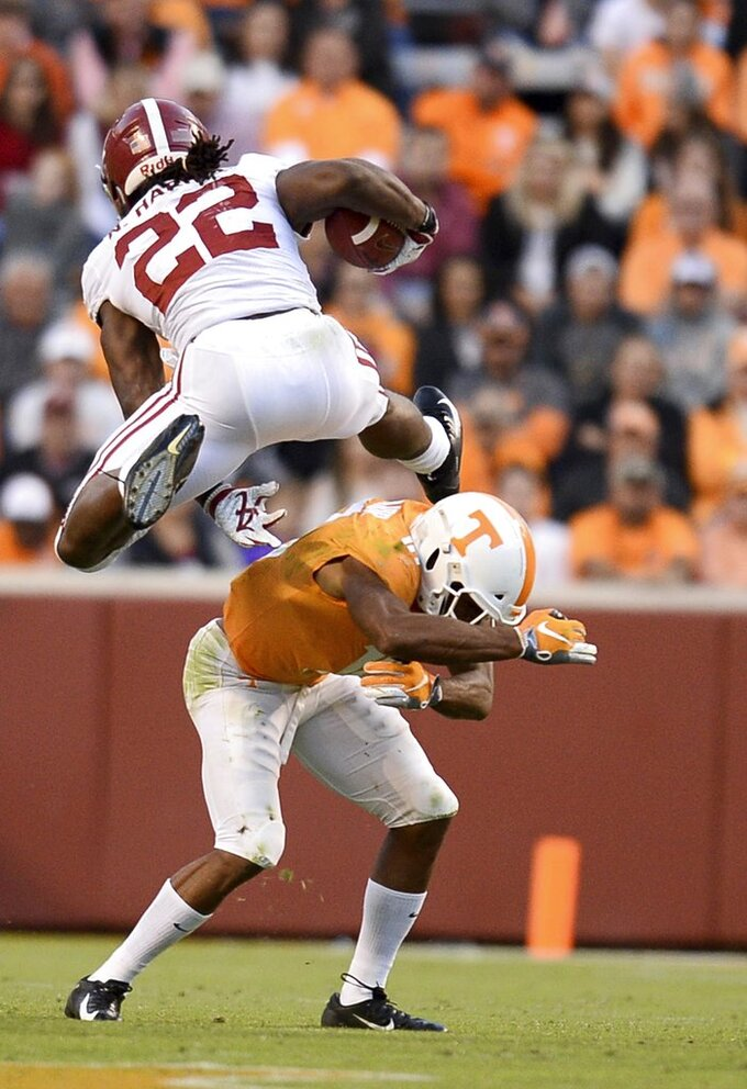 Alabama running back Najee Harris (22) hurtles over Tennessee defensive back Nigel Warrior (18) as he runs toward the end zone during the second half of an NCAA college football game Saturday, Oct. 20, 2018, in Knoxville, Tenn. Alabama won 58-21. (Joy Kimbrough /The Daily Times via AP)