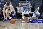 Drake's Anthony Murphy, right, and Northern Iowa's Spencer Haldeman dive after a loose ball during the second half of an NCAA college basketball game in the quarterfinal round of the Missouri Valley Conference men's tournament Friday, March 6, 2020, in St. Louis. (AP Photo/Jeff Roberson)