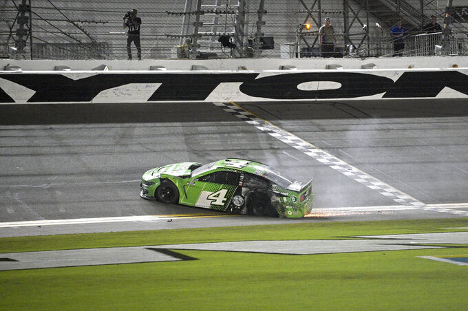 Kevin Harvick (4) slides along the front stretch after getting involved in a collision during a NASCAR Cup Series auto race at Daytona International Speedway, Saturday, Aug. 28, 2021, in Daytona Beach, Fla. (AP Photo/Phelan M. Ebenhack)