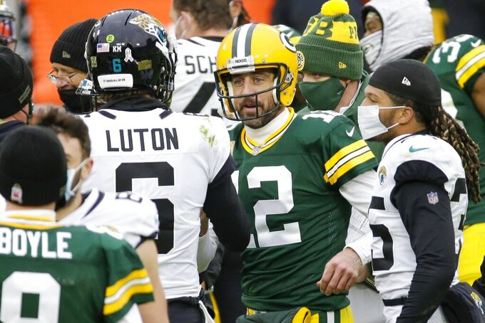 Green Bay Packers' Aaron Rodgers talks to Jacksonville Jaguars' Jake Luton after an NFL football game Sunday, Nov. 15, 2020, in Green Bay, Wis. The Packers won 24-20. (AP Photo/Mike Roemer)