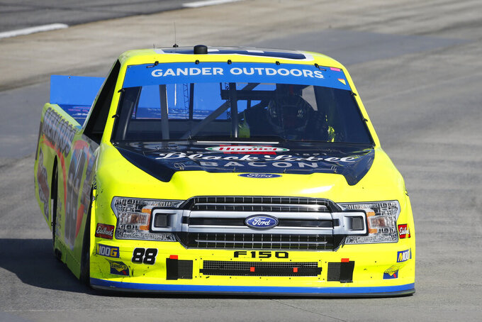Matt Crafton (88) makes the turn in turn four during the NASCAR Truck Series race at Martinsville Speedway in Martinsville, Va., Saturday, Oct. 26, 2019, (AP Photo/Steve Helber)