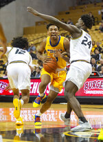 Morehead State's James Baker, center, drives between Missouri's Dru Smith, left, and Kobe Brown, right, during the first half of an NCAA college basketball game Wednesday, Nov. 20, 2019, in Columbia, Mo. (AP Photo/L.G. Patterson)