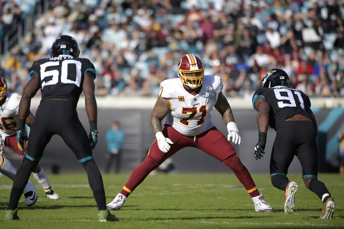 "FILE - In this Dec. 16, 2018, file photo, Washington Redskins offensive tackle Trent Williams (71) sets up to block in front of Jacksonville Jaguars defensive end Yannick Ngakoue (91) during the second half of an NFL football game in Jacksonville, Fla. Browns general manager John Dorsey acknowledged having ""a few conversations"" lately with Redskins GM Bruce Allen. With the trading deadline approaching, Dorsey could be tempted to improve Cleveland's offensive line and the Redskins are at an impasse with seven-time Pro Bowl left tackle Trent Williams, who hasn't played this season due to a contract holdout. As he finished his news conference Wednesday, Oct. 16, 2019, Dorsey was asked if he has asked Allen about trading Williams.""It takes two to tango,"" Dorsey said as he left the podium.(AP Photo/Phelan M. Ebenhack, File)"