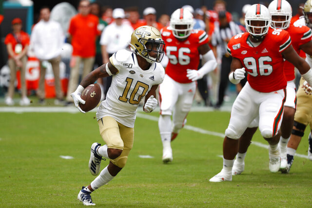 FILE - In this Saturday, Oct. 19, 2019, file photo, Georgia Tech wide receiver Ahmarean Brown runs for yardage during the first half of an NCAA college football game against Miami, in Miami Gardens, Fla. The Yellow Jackets will need big years from their receivers if they are to improve upon last season's unit, which finished 124th in scoring and fourth-worst among FBS schools in total offense.(AP Photo/Wilfredo Lee, File)