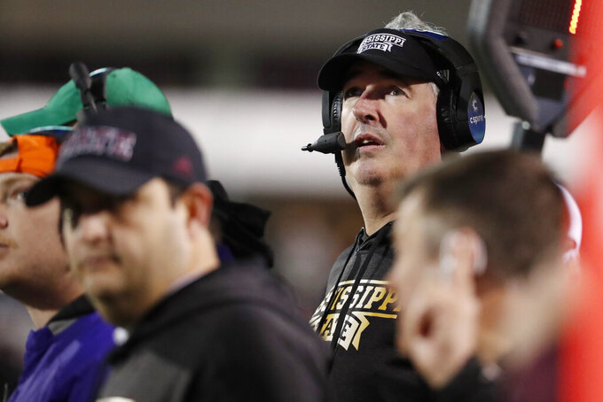 Mississippi State coach Joe Moorhead watches the seconds tick off the field monitor during the second half of the team's NCAA college football game against Mississippi in Starkville, Miss., Thursday, Nov. 28, 2019. Mississippi State won 21-20. (AP Photo/Rogelio V. Solis)
