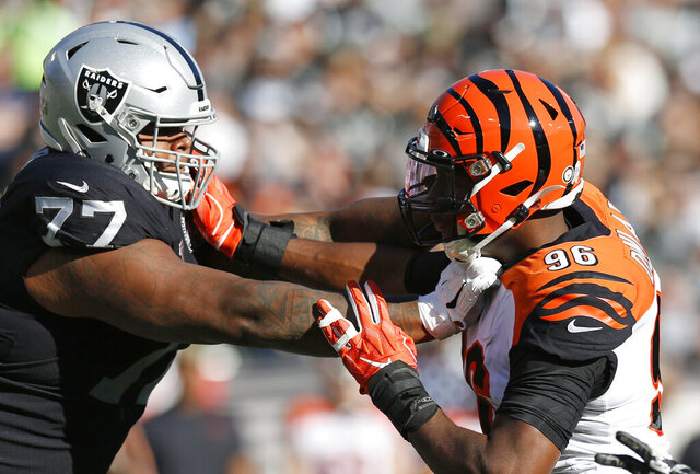 "FILE - In this Nov. 17, 2019, file photo, Oakland Raiders offensive tackle Trent Brown (77) blocks Cincinnati Bengals defensive end Carlos Dunlap (96) during the first half of an NFL football game in Oakland, Calif. The Raiders placed Brown on season-ending injured reserve, one day after the big right tackle was named to his first Pro Bowl. Brown, who this past offseason signed a contract making him the highest-paid offensive lineman in NFL history, has missed the past two games because of a pectoral injury after sitting out one game earlier in the season with an ankle injury. ""His pec is just not getting any better,"" Raiders coach Jon Gruden said Wednesday, Dec. 18. ""It's disappointing. Obviously what he did put on tape was very impressive."" (AP Photo/D. Ross Cameron, File)"