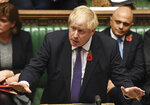 Britain's Prime Minister Boris Johnson speaks to lawmakers during the election debate in the House of Commons, London, Monday Oct. 28, 2019.   Lawmakers on Monday rejected Johnson's call for a December national election, in the hope of breaking the political deadlock over Brexit. (Jessica Taylor/House of Commons via AP)
