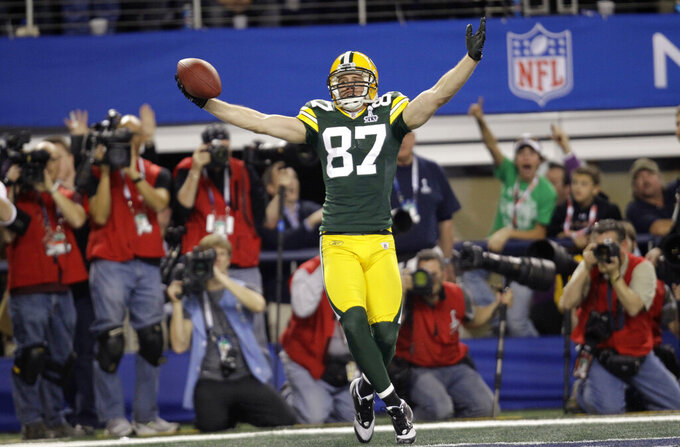 FILE - In this Feb. 6, 2011, file photo, Green Bay Packers' Jordy Nelson celebrates after he scored a touchdown against the Pittsburgh Steelers during the first half of the NFL football Super Bowl XLV game in Arlington, Texas. Nelson signed a one-day contract with the Packers on Tuesday, Aug. 6, 2019, and announced his retirement after 11 seasons, 10 of which he spent in Green Bay. (AP Photo/Eric Gay, File)