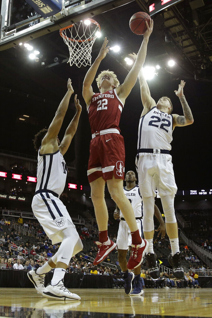 Stanford forward James Keefe (22) shoots under pressure from Butler forward Sean McDermott, right, during the first half of an NCAA college basketball game Tuesday, Nov. 26, 2019, in Kansas City, Mo. (AP Photo/Charlie Riedel)