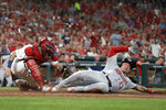 Washington Nationals' Asdrubal Cabrera (13) is tagged out at home by St. Louis Cardinals catcher Yadier Molina during the fourth inning of a baseball game Monday, Sept. 16, 2019, in St. Louis. (AP Photo/Jeff Roberson)