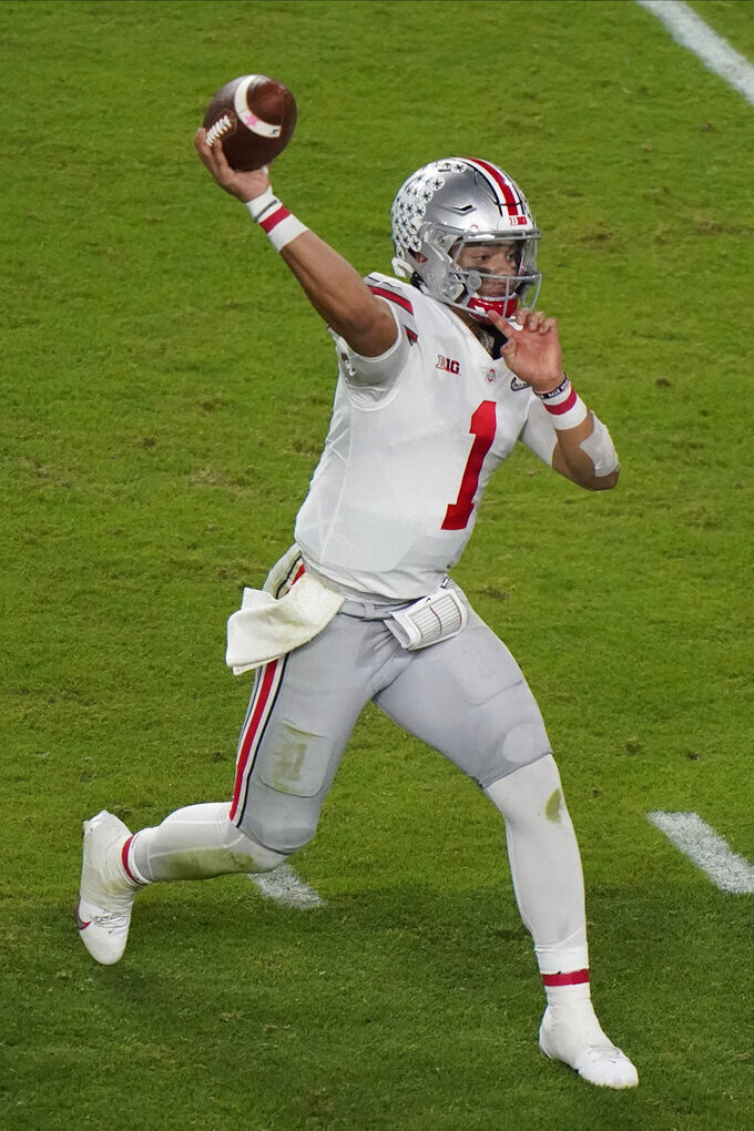 Ohio State quarterback Justin Fields passes against Alabama during the first half of an NCAA College Football Playoff national championship game, Monday, Jan. 11, 2021, in Miami Gardens, Fla. (AP Photo/Wilfredo Lee)