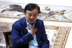 China tech giant Huawei's founder Ren Zhengfei speaks during an interview at the Huawei campus in Shenzhen in Southern China's Guangdong province on Tuesday, Aug. 20, 2019. Ren said he expects no relief from U.S. export curbs due to the political climate in Washington but expresses confidence the company will thrive with its own technology. (AP Photo/Ng Han Guan)