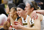 Iowa forward Megan Gustafson, second from right, celebrates with teammate Hannah Stewart, right, at the end of a second-round women's college basketball game against Missouri in the NCAA Tournament, Sunday, March 24, 2019, in Iowa City, Iowa. (AP Photo/Charlie Neibergall)