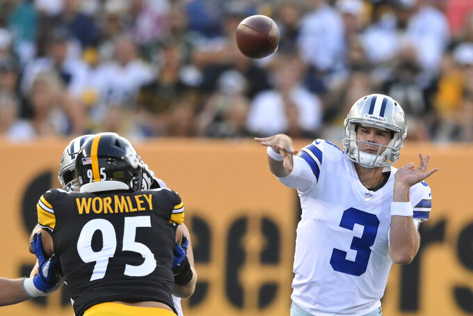 Dallas Cowboys quarterback Garrett Gilbert (3) throws a pass past Pittsburgh Steelers' Chris Wormley during the first half of the Pro Football Hall of Fame NFL preseason game Thursday, Aug. 5, 2021, in Canton, Ohio. (AP Photo/David Richard)