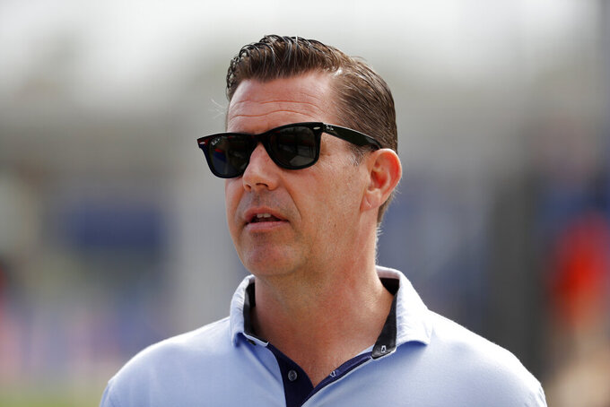 FILE - In this Feb. 15, 2020, file photo, New York Mets general manager Brodie Van Wagenen watches spring training baseball practice in Port St. Lucie, Fla. Van Wagenen and many of his top aides are out, moves announced less than an hour after hedge fund manager Steve Cohen completed his $2.4 billion purchase of the team Friday, Nov. 6, 2020.  (AP Photo/Jeff Roberson, File)