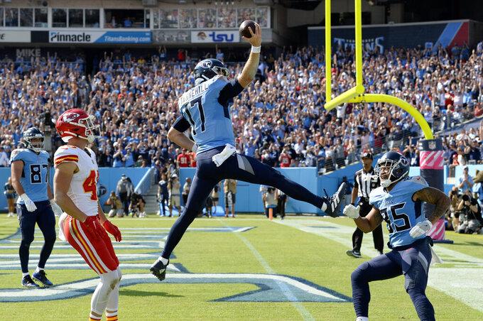Tennessee Titans quarterback Ryan Tannehill (17) scores a touchdown against the Kansas City Chiefs in the first half of an NFL football game Sunday, Oct. 24, 2021, in Nashville, Tenn. (AP Photo/Mark Zaleski)